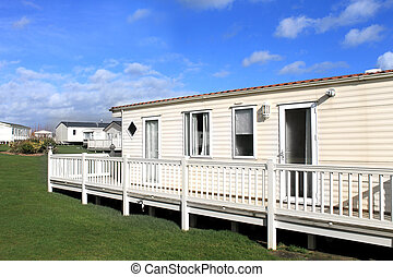 Caravan on trailer park - Side view of modern caravan on...