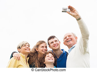 Smiling family taking photos - Happy family taking a...