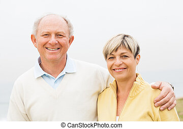 Happy middle aged couple - Smiling middle aged couple posing...