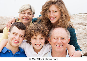 Happy family posing together - Family enjoying their summer...