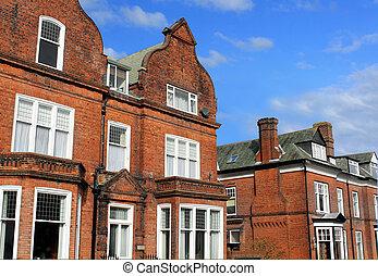 Row of red brick houses in street
