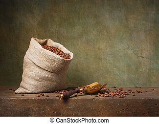 Still life with coffee beans in a bag and scoop