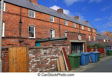 Terraced house in England - Terraced house with recycling...