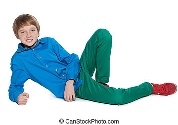 Preteen boy is lying on the white background - A fashion...