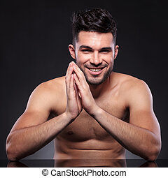 naked young man with smile on face