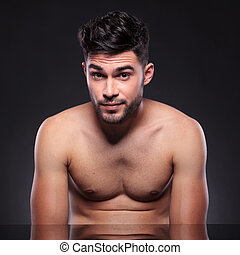 naked young man with raised eyebrows