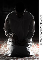Muslim Man Is Praying In The Mosque - Young Muslim Man...