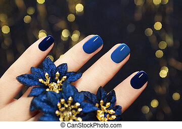 Blue lacquer . - Manicure on women's hands are covered with...