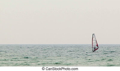 Man adores serfing in the Black Sea