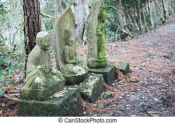 Japanese God Idol in woods, nobody