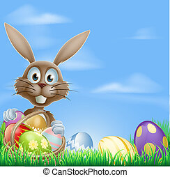 Easter bunny and chocolate eggs - Easter bunny rabbit in a...