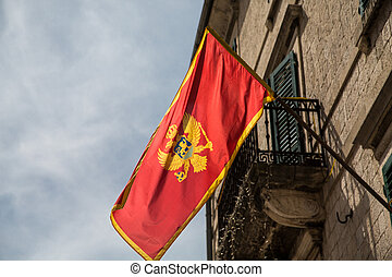 Montenegro Flag Over Kotor - Red flag of Montenegro on an...