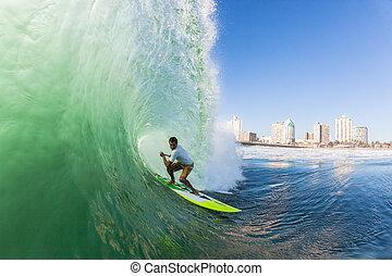 Surfer SUP Inside Hollow Wave - Surfer inside hollow wave...