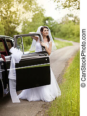 Beautiful Bride with retro car Outdoor wedding portrait