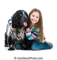 little girl with her cocker spaniel puppy dog - Happy cute...