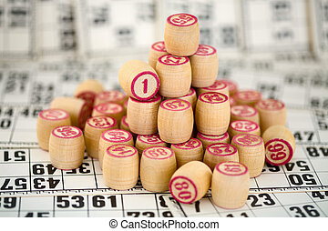 Wooden counters of bingo on cards - Wooden counters of bingo...
