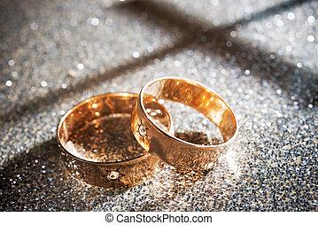 Wedding Rings - golden wedding rings on the goldene...