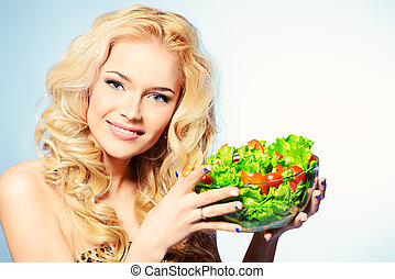 healthy life - Portrait of a beautiful young woman eating...