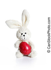 Stuffed easter bunny with red egg