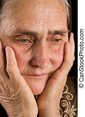 Old woman in sadness