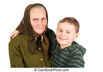 Grandmother and nephew embracing - old peasant woman...