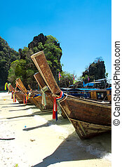 Long tail boat on tropical beach , Krabi, Thailand