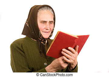 Old peasant woman reading - Close-up portrait of an old...