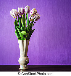 Bouquet of beautiful tulips flowers in vase on table in...