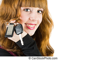 Sales woman offering car keys - Young attractive sales woman...