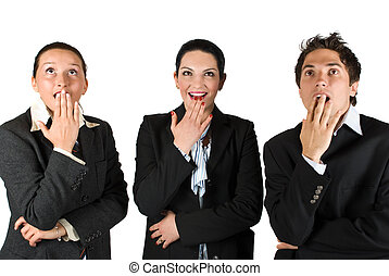 Surprised business people - Three business people standing...