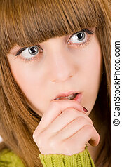 Teenager deeply in thoughts - Close-up portrait of a pensive...