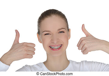 Smiling happy girl with braces isolated on white