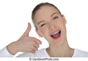 Smiling girl with braces isolated on white
