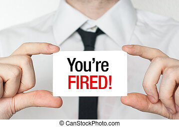 You're fired card - Business man holding a card with you're...