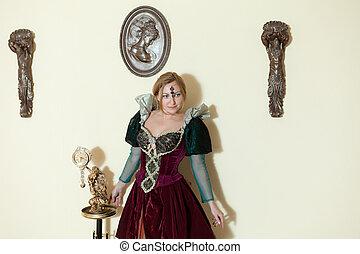 girl in medieval dress posing