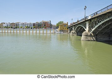 Triana Bridge in Seville Andalusia, Spain, connects the...