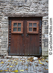 Vintage wooden door of the Tallinn city, the capital of...