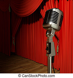 Red stage theater drapes and microphone