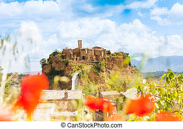 Bagnoregio fort, Lazio, Italy through poppy flower
