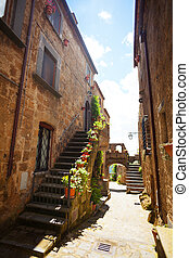 Narrow streets of Bagnoregio with staircase and flower,...