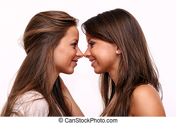 Beauty portrait of two beautiful young women - Portrait of...