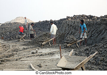 Brick field workers - Brick field. Laborers are carrying...