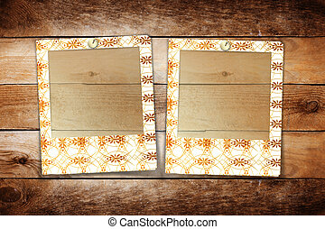 Slides with handmade ornaments for photos on wooden abstract background