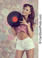 sexy pin-up with vinyl disc