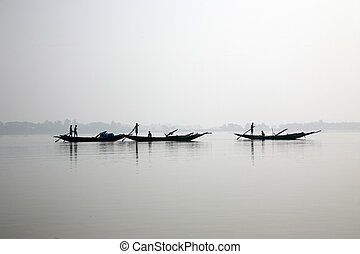 Fishermen on a boat - Some fishermen on a boat in...