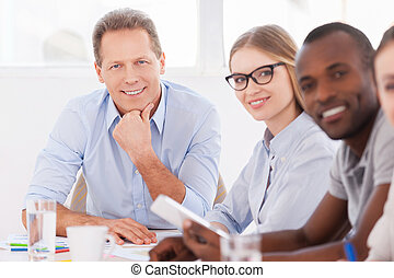 Strong and creative team leader Confident mature man sitting...