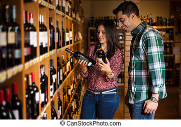There are so many options of wine! - Cute young Hispanic...