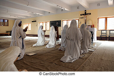 Sisters of Mother Teresa's Missionaries of Charity in prayer...