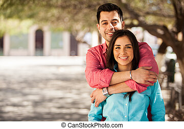 Cute young couple outdoors - Portrait of a cute young couple...