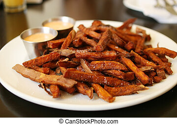 Sweet Potato Fries - Plate of sweet potato fries with side...